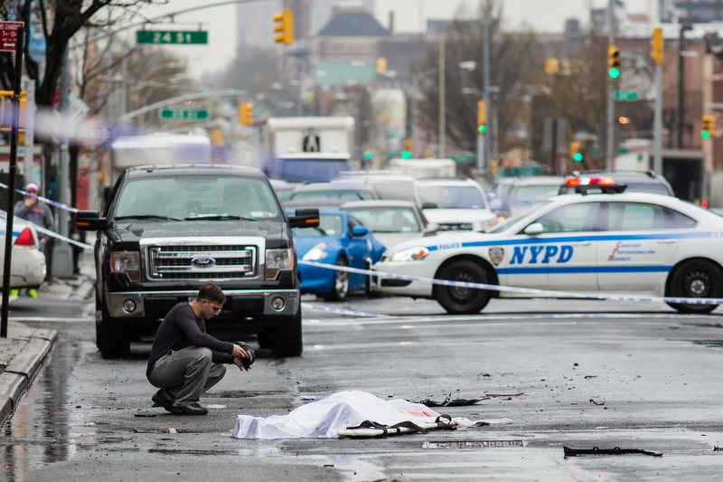 Third Place Stefan Thomas Jeremiah /NY Post Freelance - UNTITLED A man kneels over the covered body of a friend at the scene of a hit and run at 4th Avenue and 22nd Street in Sunset Park, Brooklyn on Monday April 4, 2016 in New York City, USA. An unidentified male was struck and killed after trying to stop a thief from driving away with his company's truck.