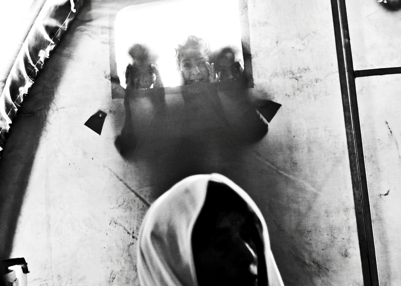 First PlaceByron Smith/FreelanceKHAZIR CAMP KIDSChildren at Khazir Camp peek inside of a tent as they join over 70,000 internally displaced people fleeing violence as Iraqi Security Forces move to clear in Mosul, Iraq, of terrorists, December 4, 2016. Nearly two years after the Islamic State took the city in northern Iraq, the Iraqi Army launched an offensive to wrest the city back from the insurgency in October of 2016.