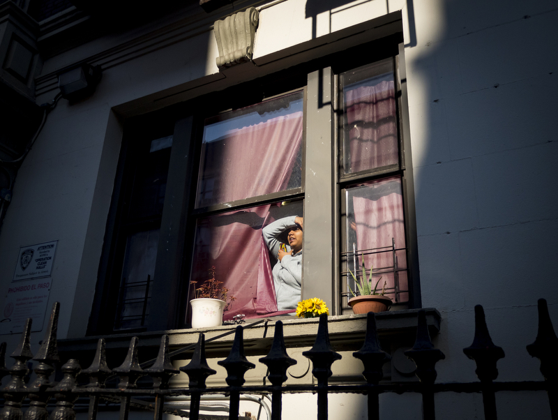 Exhibit AwardAnthony Delmundo/Daily NewsA TERRIBLE SIGHTA woman peers out her window as the NYC Office of Chief Medical Examiner removes the body of a man who is known to building residents as George at the scene of the fatal fire at the basement of 603 West 184th Street in Washington Heights, New York on November 16, 2016.
