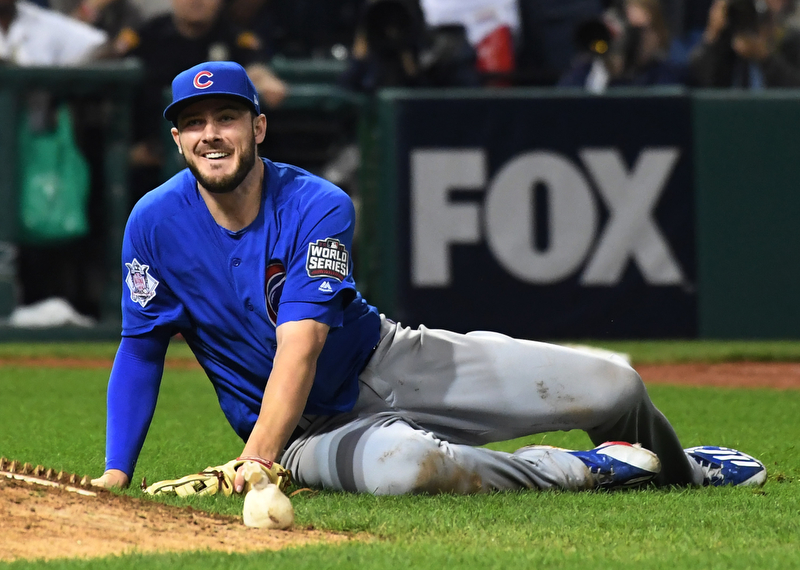 Chicago Cubs third basemen Kris Bryant smiles as he watches his throw to first to retire Cleveland Indians Michael Martinez for the final out in the 10th inning of game 7 of the World Series in Cleveland, Ohio in the early morning of November 3, 2016.  Bryant was the World Series MVP and Chicago won 8-7 to celebrate their first World Series championship in 108 years.