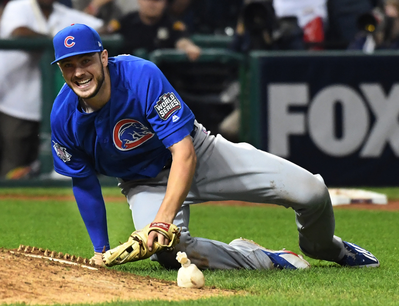 Chicago Cubs third basemen Kris Bryant smiles as his throw retires Cleveland Indians Michael Martinez for the final out in the 10th inning of game 7 of the World Series in Cleveland, Ohio in the early morning of November 3, 2016.  Bryant was the World Series MVP and Chicago won 8-7 to celebrate their first World Series championship in 108 years.