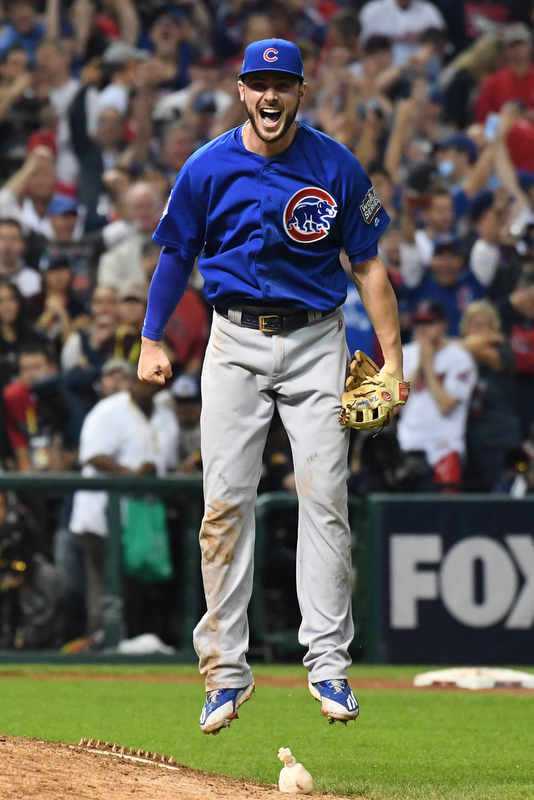 Chicago Cubs third basemen Kris Bryant leaps in jubilation as his throw retires Cleveland Indians Michael Martinez for the final out in the 10th inning of game 7 of the World Series in Cleveland, Ohio in the early morning of November 3, 2016.  Bryant was the World Series MVP and Chicago won 8-7 to celebrate their first World Series championship in 108 years.