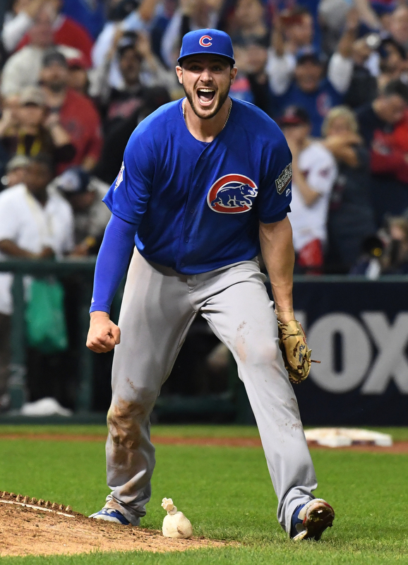 Chicago Cubs third basemen Kris Bryant screams in jubilation as his throw retires Cleveland Indians Michael Martinez for the final out in the 10th inning of game 7 of the World Series in Cleveland, Ohio in the early morning of November 3, 2016.  Bryant was the World Series MVP and Chicago won 8-7 to celebrate their first World Series championship in 108 years.