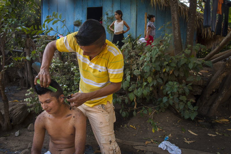 Jan. 10, 2016 - Telica, Nicaragua: Alexander Castillo, 20, gets a haircut from Milton Castro, 22, in the El Porvenir Coffee Cooperative in Telica, Jan. 10, 2016. Nicaragua, the second poorest country in the Western Hemisphere after Haiti, has been hard hit by climate change and drought but sustainable farming and irrigation projects have given some communities a means of survival.