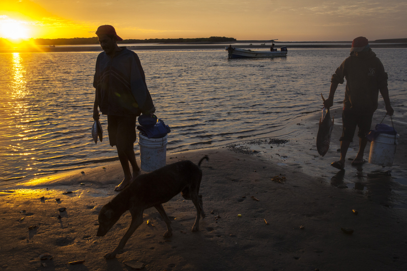 JANUARY 11, 2016 - Las Penitas, Nicaragua: Fishermen return from an all-night outing with their haul in La Penitas, Nicaragua, Jan. 11, 2016. Nicaragua, the second poorest country in the Western Hemisphere after Haiti, has been hard hit by climate change and drought but sustainable farming and irrigation projects have given some communities a means of survival.