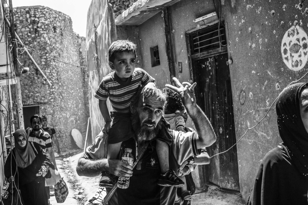Days after the Iraqi government declared the Islamic State was defeated in Mosul, heavy fighting persisted while newly liberated residents still fled the Old City neighborhood in droves on June 30, 2017. With temperatures reaching 115 degrees, many needed medical attention for heat exhaustion.