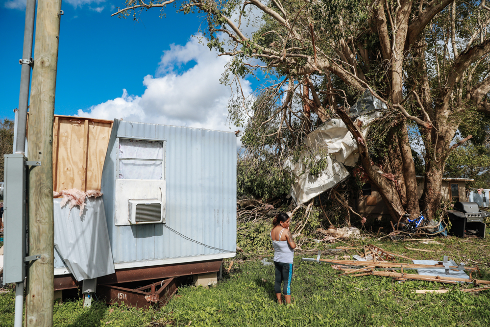 September 12, 2017: Immokalee, FL - Sandra Guzman near her trailer which was destroyed  by hurricane Irma. The town of Immokalee, home to migrant farm workers and immigrants from Haiti and Latin America, was one of the hardest hit by the category 5 storm.