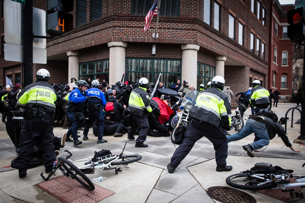 A police officers kettle and mass arrest Black Bloc anarchist protestors during the mayhem on Inauguration Day near Franklin Square on January 20, 2017 in Washington, DC, USA.Thousands of people poured into Washington, DC to protest Donald Trump'sinauguration. Police arrested a total of 217 participants in the 'Disrupt J20'protest, and charged with felony rioting. Among them are journalists, nurses, and dozens of others who say they did nothing illegal.