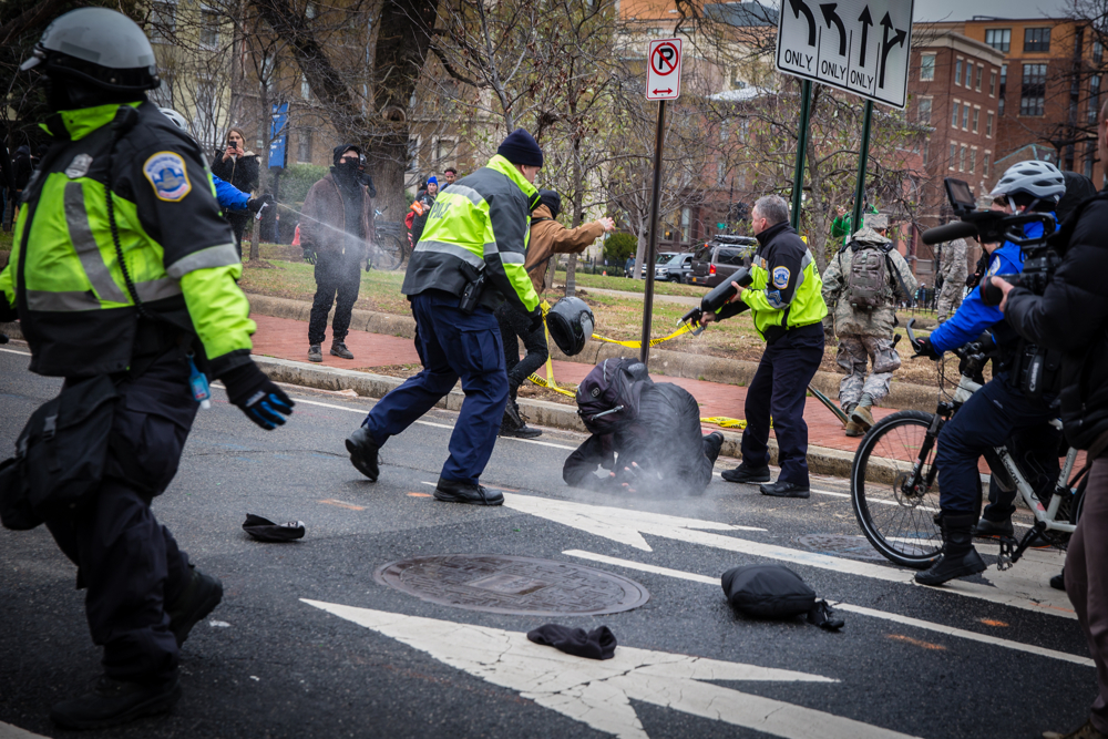 Police officers pepper spray a Black Bloc anarchist protestor during the mayhem on Inauguration Day near Franklin Square on January 20, 2017 in Washington, DC, USA.Thousands of people poured into Washington, DC to protest Donald Trump'sinauguration. Police arrested a total of 217 participants in the 'Disrupt J20'protest, and charged with felony rioting. Among them are journalists, nurses, and dozens of others who say they did nothing illegal.