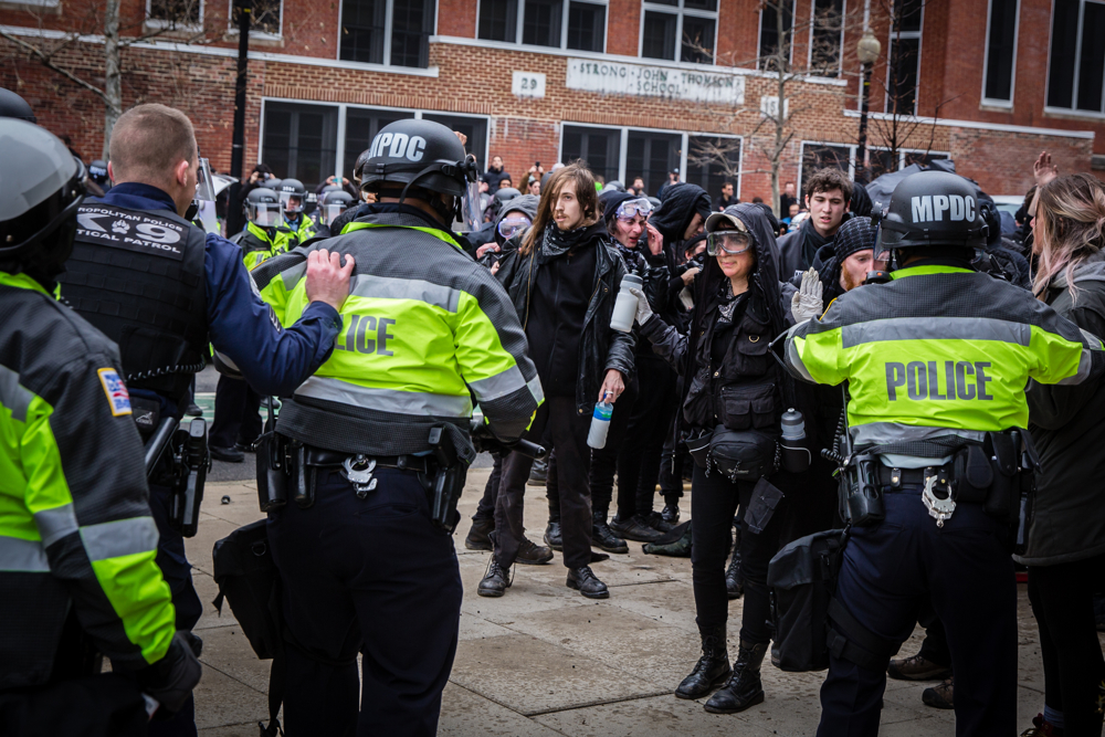 Police officers kettle and mass arrest Black Bloc anarchist protestors during the mayhem on Inauguration Day near Franklin Square on January 20, 2017 in Washington, DC, USA.