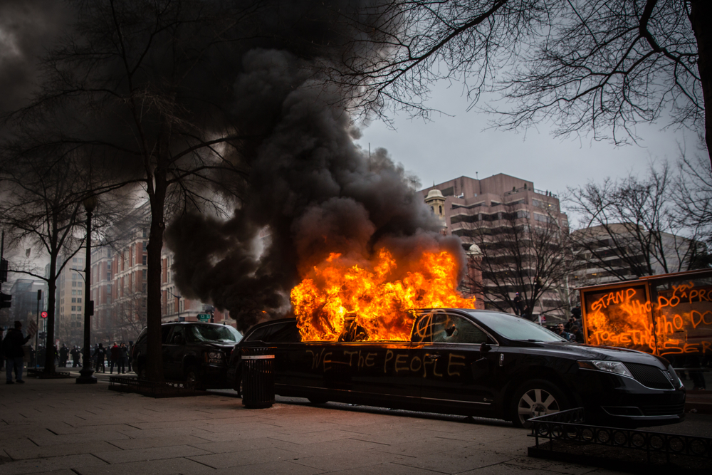 A limousine is set ablaze by protestors during the mayhem on Inauguration Day near Franklin Square on January 20, 2017 in Washington, DC, USA.