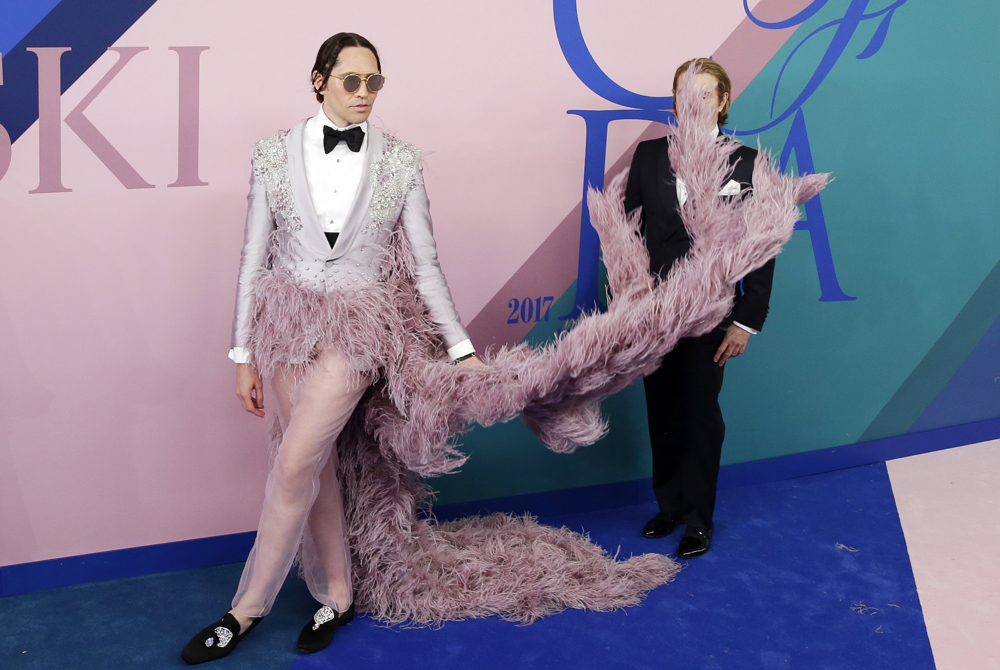 Celebrity personality Di Mondo hits a publicist with the furry train of his outfit when he arrives on the red carpet at the 2017 CFDA Fashion Awards at the Hammerstein Ballroom on June 5, 2017 in New York City.