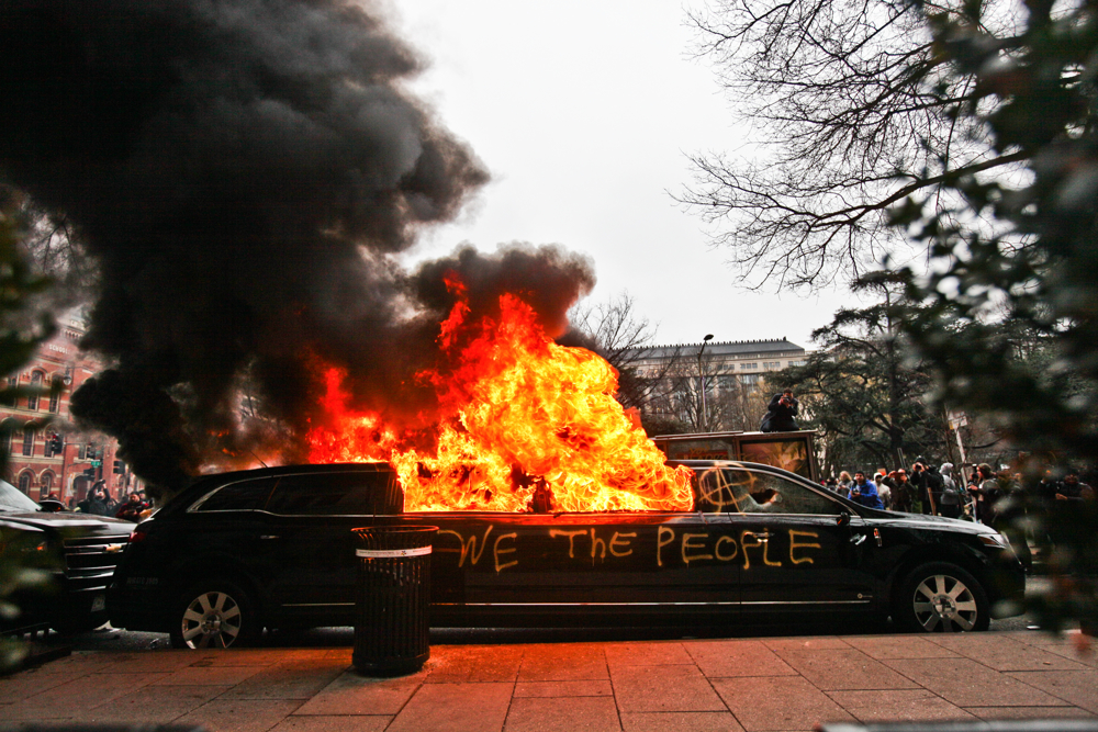 Anti-Trump protesters left a limousine on fire in front of the Washington Post headquarters near Franklin Square hours after Donald Trump was sworn in as 45th President of the United States in Washington, D.C. on January 20, 2017.