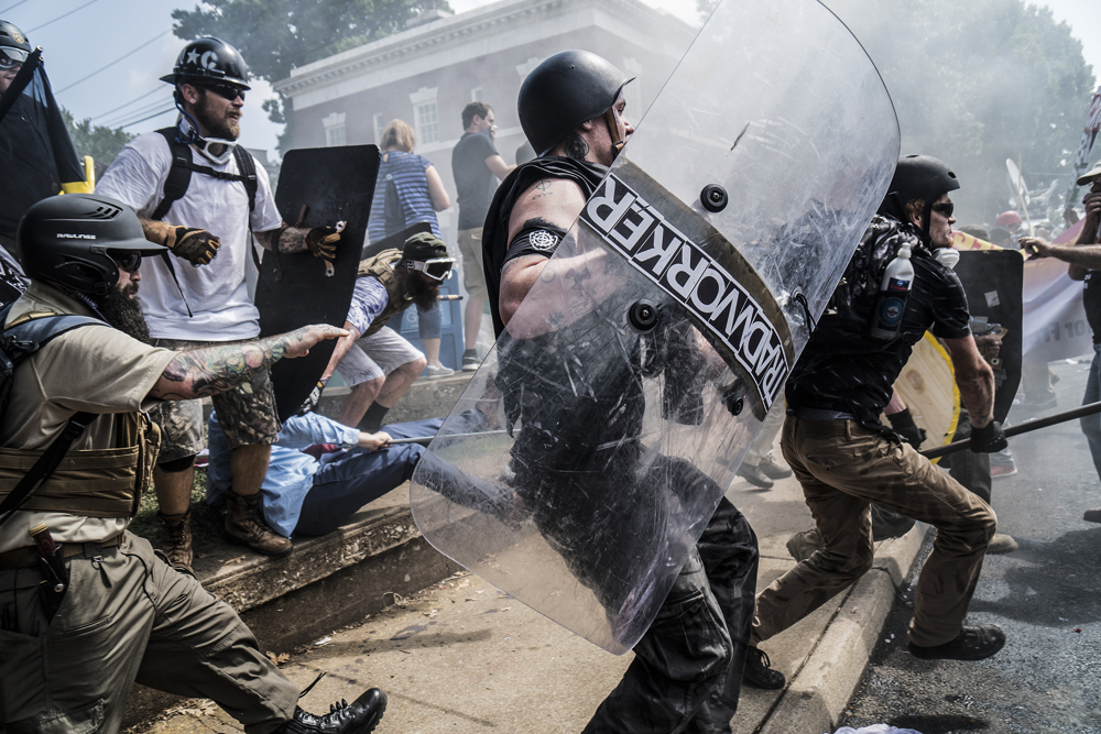 Alt-right rally members crash with counter protesters in Lee Park in Charlottesville, VA on Saturday August 12, 2017 Alt-right group and white supremest members gathered and formed a big rally in Lee Park, Charlottesville 8/12/2017Charlottesville, VA