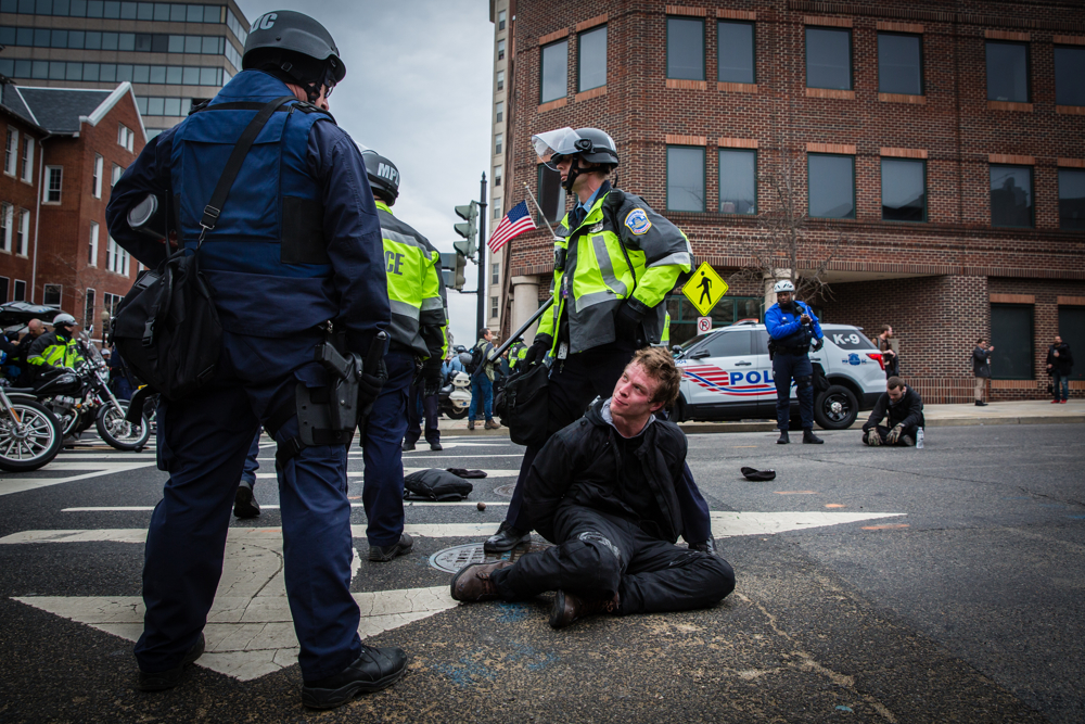 Police officers arrest a Black Bloc anarchist protestor during the mayhem on Inauguration Day near Franklin Square on January 20, 2017 in Washington, DC, USA.Thousands of people poured into Washington, DC to protest Donald Trump'sinauguration. Police arrested a total of 217 participants in the 'Disrupt J20'protest, and charged with felony rioting. Among them are journalists, nurses, and dozens of others who say they did nothing illegal.