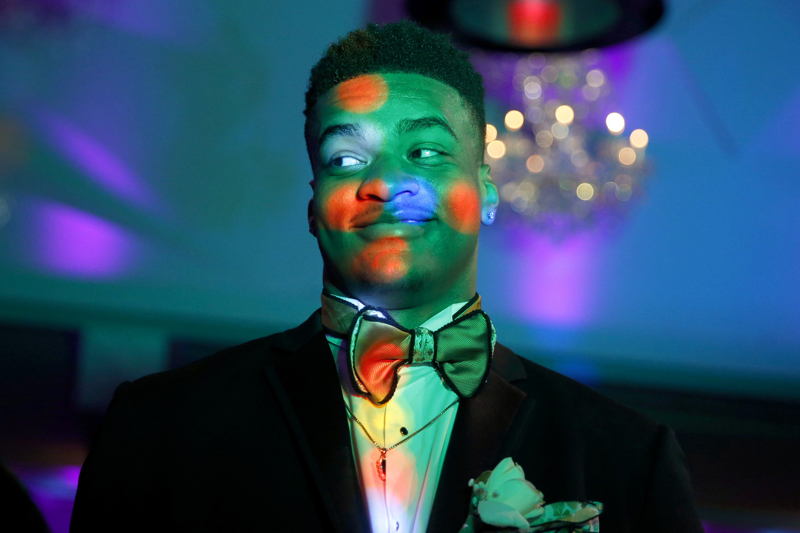 Enlightened Next To DJ - A student stands next to the DJ booth as he gets illuminated at Newark's East Side High School 2017 prom at the Westmount Country Club with the students dancing to the music of DJs Unlimited. Wednesday May 31, 2017. Woodland Park, NJ, USA