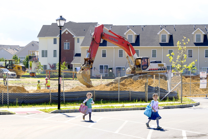 More Housing - A pair of girls cross the street in the Lakewood Commons affordable housing project. There are already 192 units with another 66 coming. The complex built with the help of federal grants is predominately Orthodox with only one Hispanic family living there.  Tuesday July 18, 2017. Lakewood, NJ, USA