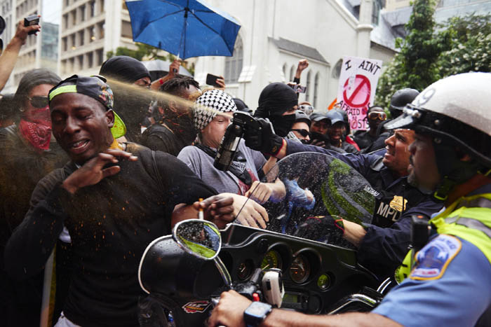 Police officers deployed pepper spray on counter-protesters during the second Unite the Right march on August 12, 2018 in Washington, D.C.  Dozens of people were seriously injured and one woman died in the first Unite the Right rally last year in Charlottesville, Virginia.