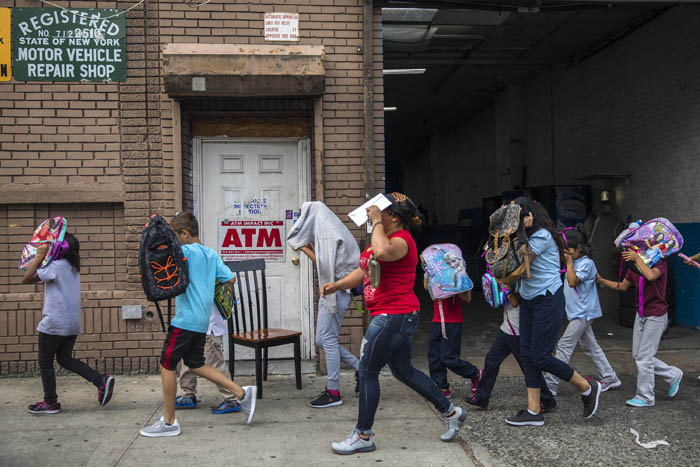 Children, who are separated from their parents at the southern border of the United States, leave a shelter in Harlem, New York, June 20, 2018. Under cover of darkness and in the custody of the federal government, migrant children have been coming in waves to New York, taken from their parents after crossing the southern border.