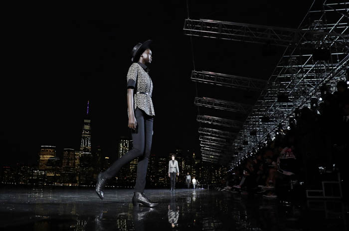 A model walks on the runway at the Saint Laurent Spring 2019 menswear collection at Liberty State Park on June 6, 2018 in Jersey City, New Jersey. Saint Laurent's hosted the show using One World Trade Center and the buildings of Lower Manhattan as a backdrop.