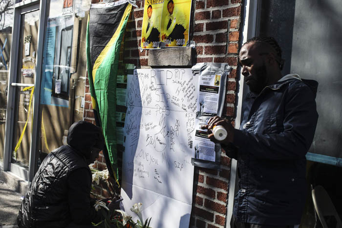 Friends  who knew Saheed Vassell write notes and light candles near the scene where Vassell was shot by the NYPD on the corner of Utica Avenue and Montgomery Street in Brooklyn on Thursday, April 5, 2018.  Vassell was a mentally disturbed individual beloved by the community and was killed when an officer opened fire when he looked as if he had a firearm but turned out to be a piece of metal.