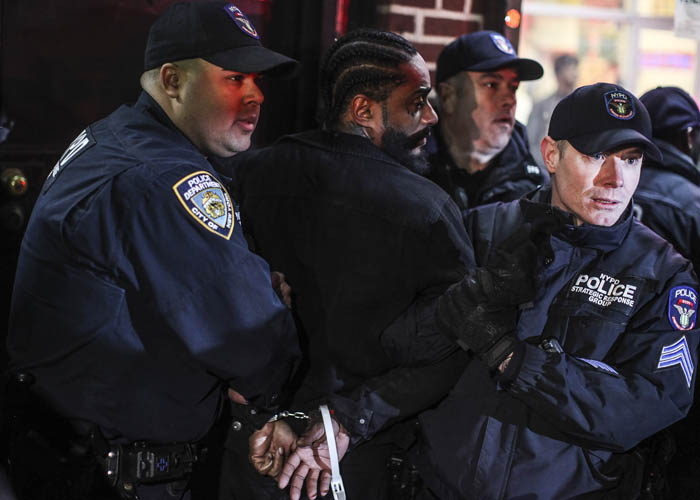 A man is arrested after throwing eggs at NYPD vehicles as protesters came out to rally and march in memory of Saheed Vassell, a man who was shot unarmed by the NYPD the day before, at the corner of Montgomery Street and Utica Avenue in Brooklyn on Thursday, April 5, 2018. Vassell was a mentally disturbed individual beloved by the community and was killed when an officer opened fire when he looked as if he had a firearm but turned out to be a piece of metal.