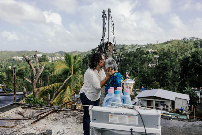 February 12, 2018: Naranjito, Puerto Rico -  Family friends comfort each other in the hills of Naranjito.  Nearly 5 months after Hurricane Maria reached the island around 1/3 of Puerto Rico is still without power.  After a catastrophic hurricane, rates of mental illness continue to rise.