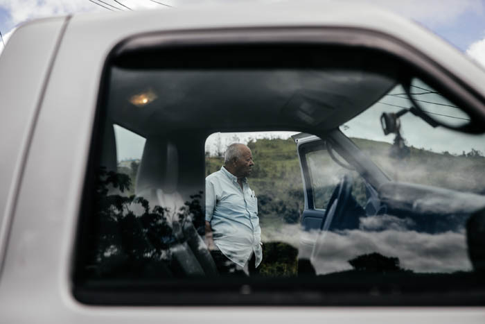February 12, 2018: Naranjito, Puerto Rico -  Angel Luis Ortiz, 84, retired business owner, near his home. Ortiz's son, Ramon Ortiz, committed suicide on Thanksgiving 2017. Nearly 5 months after Hurricane Maria reached the island around 1/3 of Puerto Rico is still without power.  After a catastrophic hurricane, rates of mental illness continue to rise.