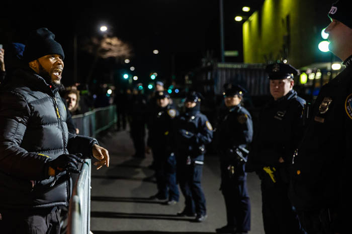 A man shouts at NYPD officers as demonstrators gather on Empire Boulevard to protest outside the 71st Precinct in Crown Heights, Brooklyn on April 5, 2018 in New York City, USA.  