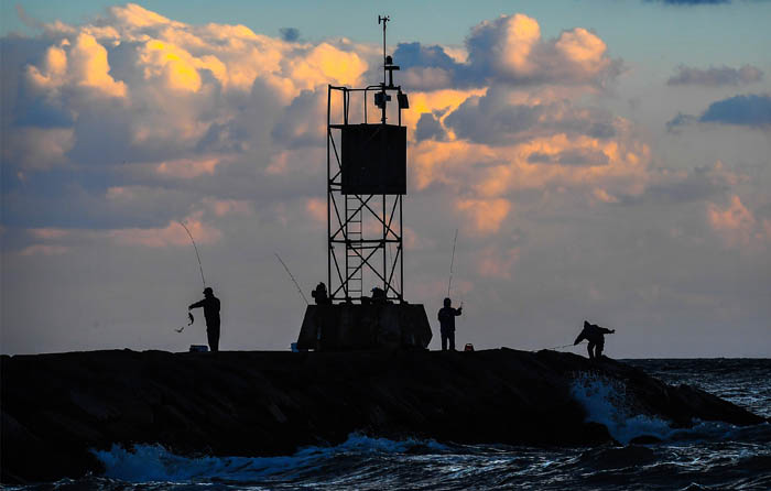 Fisherman gather at dusk to test their skills at the Shinnecock Inlet in Hampton Bays on the afternoon Oct. 17, 2018