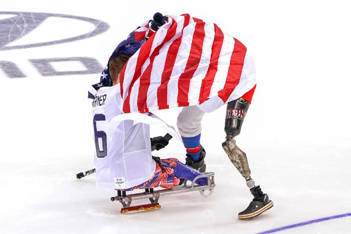SUNDAY, Mar. 18 2018 - Gangneung, SOUTH KOREA: Declan FARMER of USA, left, #16, celebrated USA's win over Canada with Jen LEE. USA won the Gold Medal game vs. Canada in Overtime after they came back from behind with 38 seconds left in the 3rd period at Gangneung Hockey Centre.