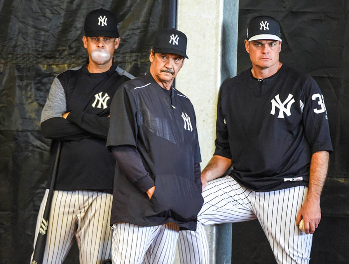 New York Yankees Manager Aaron Boone, Guest Instructor, Ron Guidrey, and Minor League Pitching Coordinator, Scott Aldred, watch during Bullpen sessions on day three of Spring Training at George M. Steinbrenner Field in Tampa Florida. Feb. 15, 2018