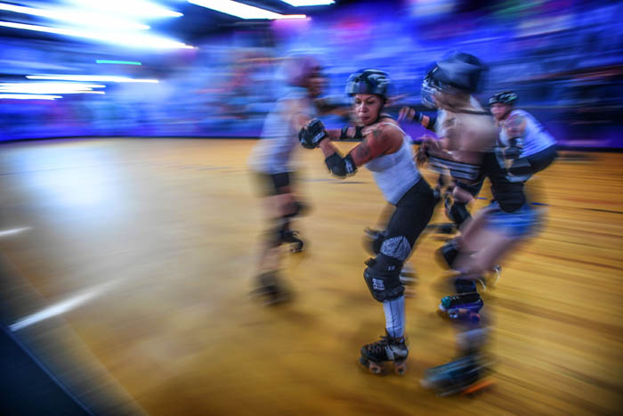 In a flurry of motion, members of the Long Island Roller Rebels Roller Derby League practice late in the evening at the United Skates roller rink in Wantagh. June 21, 2018.