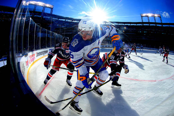 Jan 1, 2018; Queens, NY, USA; Buffalo Sabres center Jack Eichel (15) battles for the puck with New York Rangers defenseman Marc Staal (18) and defenseman Brady Skjei (76) during the first period of the 2018 Winter Classic at Citi Field.
