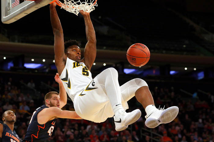 Feb 28, 2018; New York, NY, USA; Iowa Hawkeyes forward Tyler Cook (5) dunks over Illinois Fighting Illini forward Michael Finke (43) during the first half of a first round game of the 2018 Big Ten Tournament at Madison Square Garden.