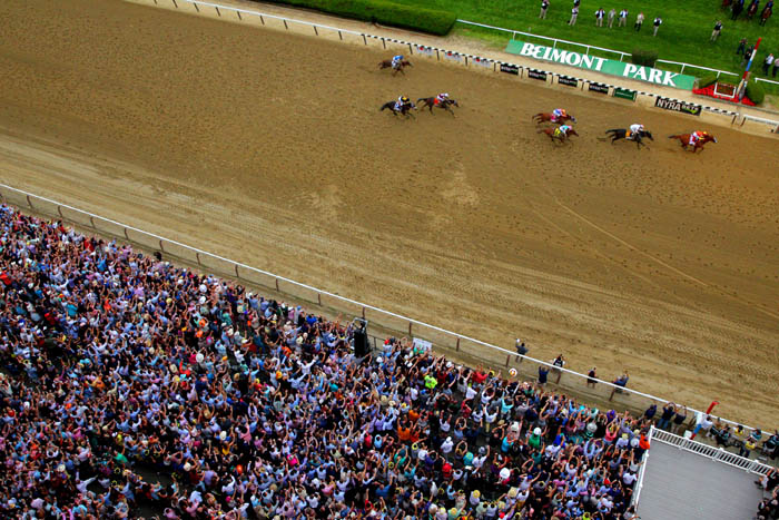 Jun 9, 2018; Elmont, NY, USA; Mike Smith aboard Justify (1) pulls away to win both the 150th running of the Belmont Stakes and Triple Crown at Belmont Park.