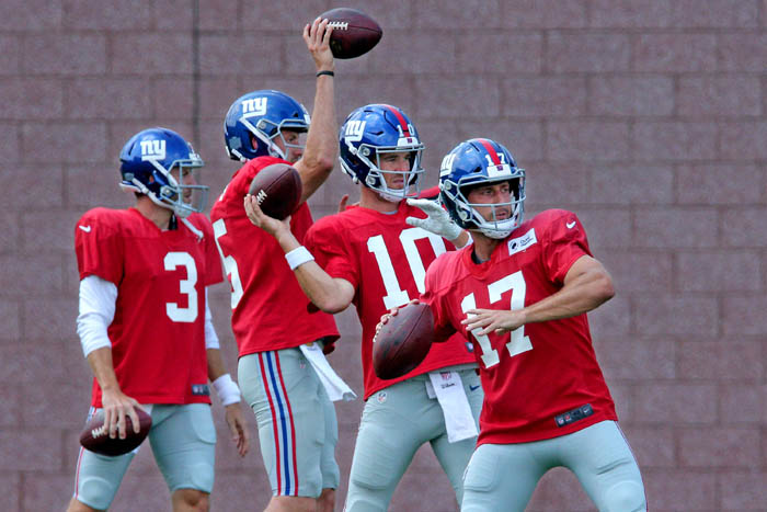 Jul 28, 2018; East Rutherford, NJ, USA; New York Giants quarterbacks Alex Tanney (3), Davis Webb (5), Eli Manning (10), and Kyle Lauletta (17) drop back to pass during a drill during training camp at the Quest Diagnostics Training Center.