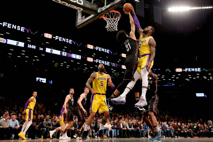 Dec 18, 2018; Brooklyn, NY, USA; Los Angeles Lakers small forward LeBron James (23) is blocked by Brooklyn Nets center Jarrett Allen (31) during the first quarter at Barclays Center.