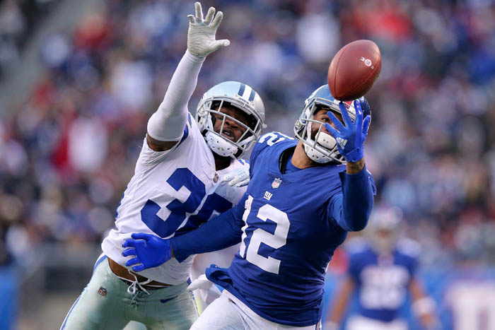 Dec 30, 2018; East Rutherford, NJ, USA; New York Giants wide receiver Cody Latimer (12) catches a pass against Dallas Cowboys cornerback Anthony Brown (30) during the fourth quarter at MetLife Stadium.