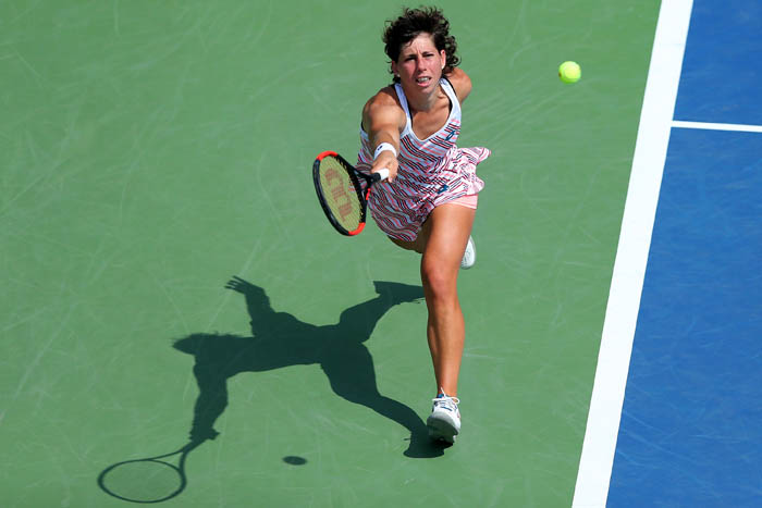 Top tennis players from around the world compete in the 2018 US Open Championships from Monday, August 27 through Sunday, September 9 at the USTA Billie Jean King National Tennis Center in Queens. Carla Suárez Navarro plays a ball on day 6.