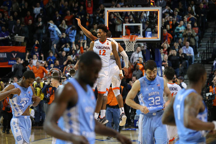 Fifteen teams competed in the 2018 Atlantic Coast Conference Tournament from Tuesday, March 6 through Saturday, March 10 at the Barclays Center in Brooklyn, NY. Virginia Cavaliers guards De'Andre Hunter (12) and Devon Hall (0) celebrate as the North Carolina Tar Heels walk off the floor after the championship game.