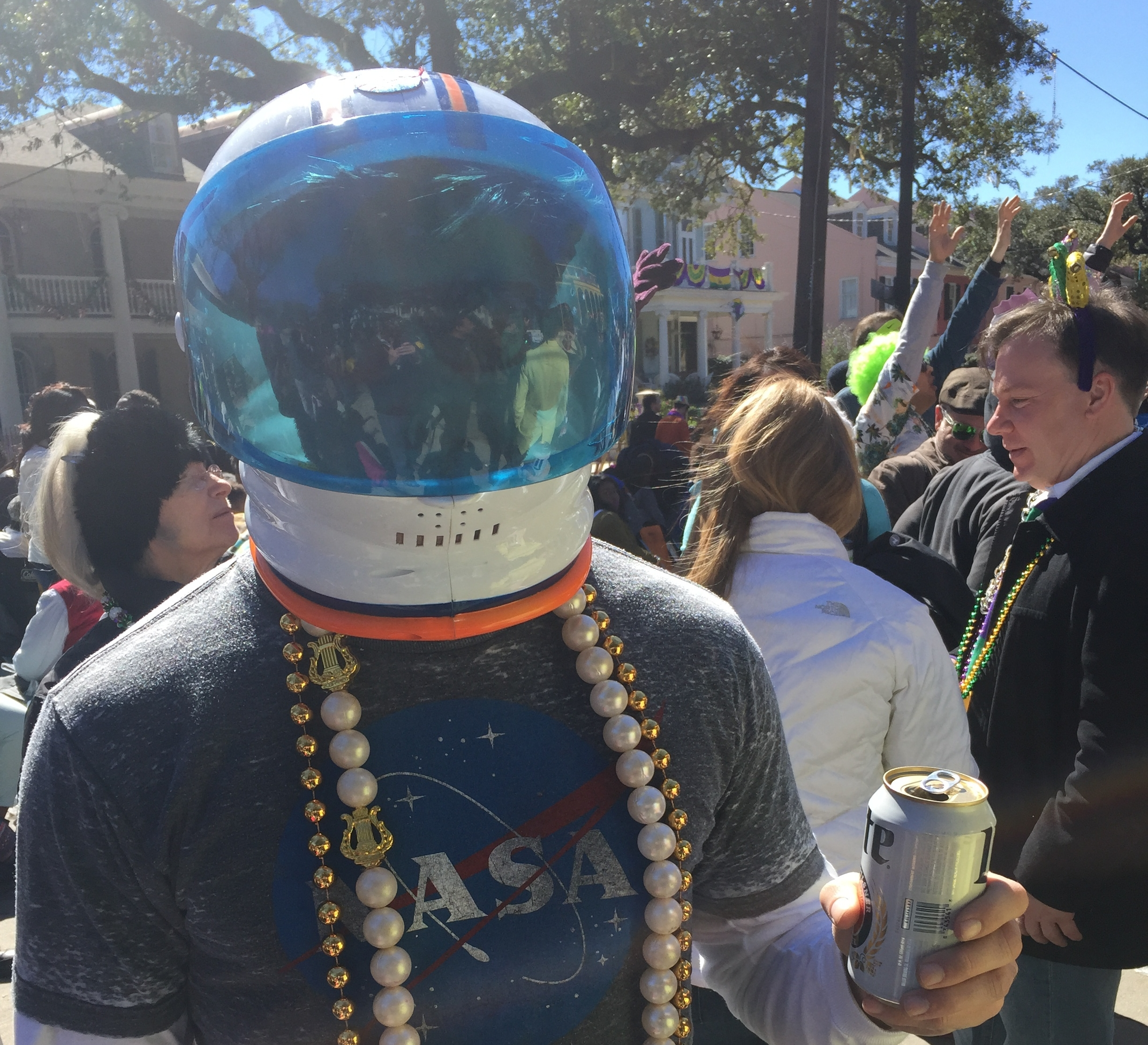 Dressing up in a costume on Mardi Gras Day in New Orleans.