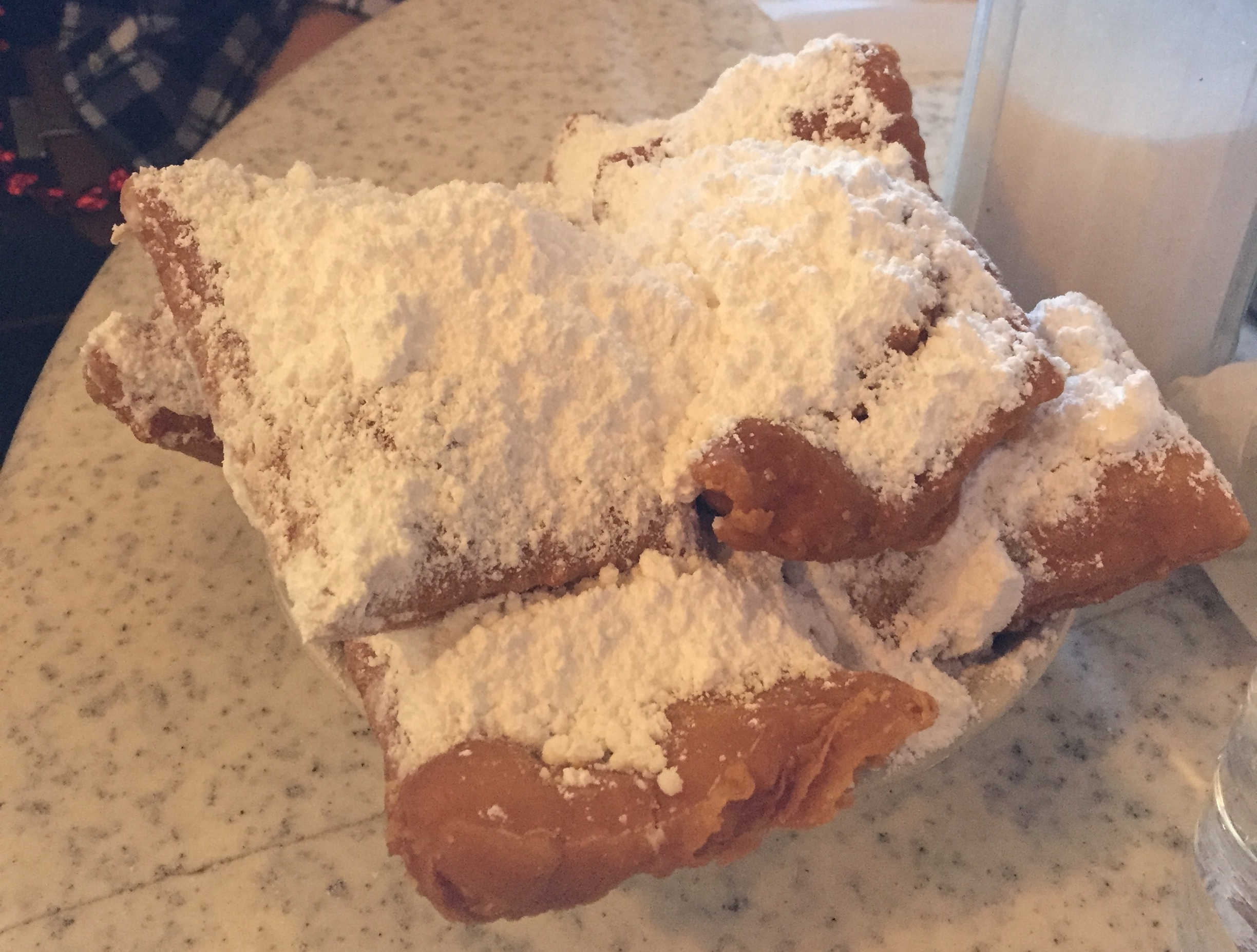 Besides King Cake, Beignets are must eat while visting New orelans for Mardi Gras.