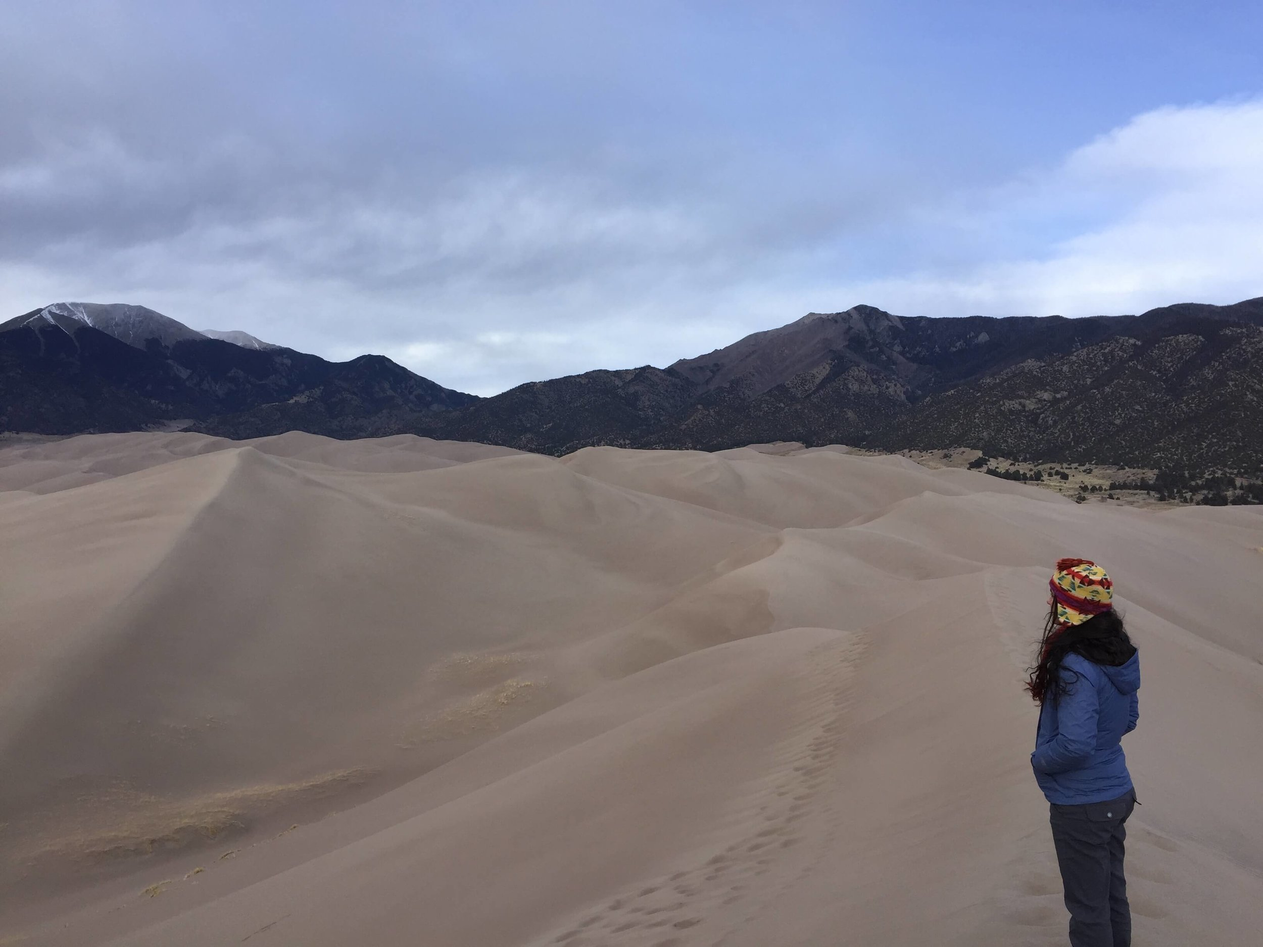Peering from the top of High Dune in Great Sand Dunes National Park and Preserve