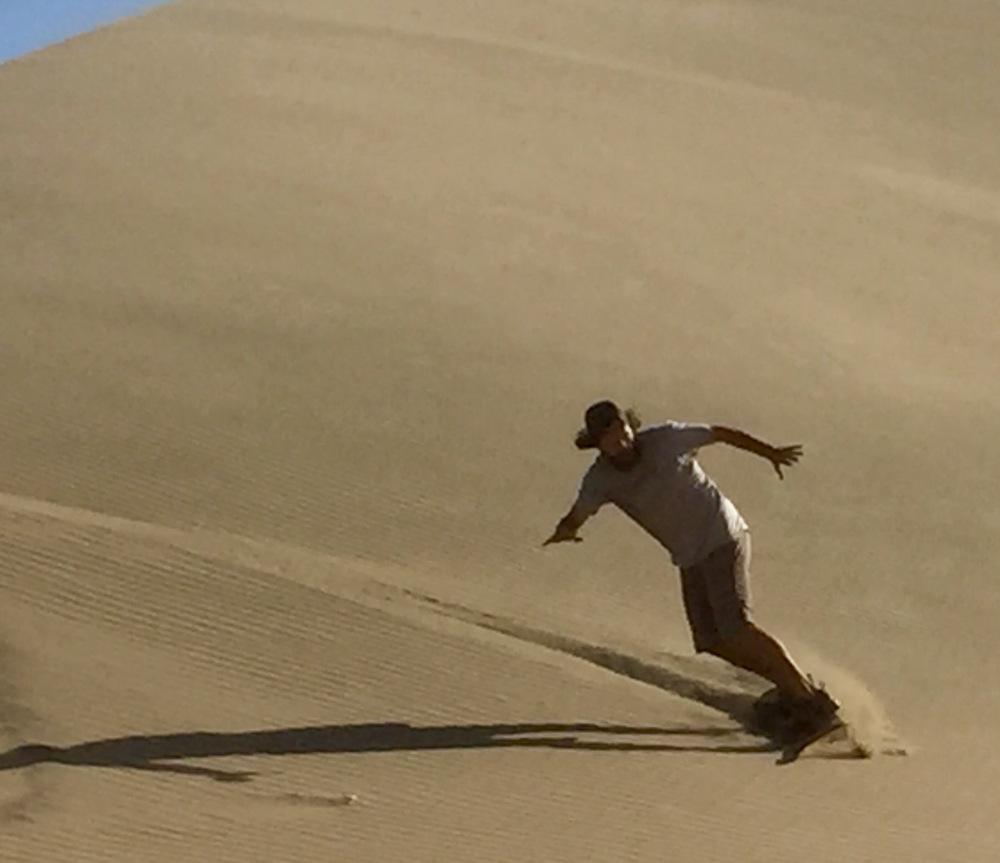 Shredding the gnar on a sand dune. Photo courtesy of  The Roaming Rhythm .
