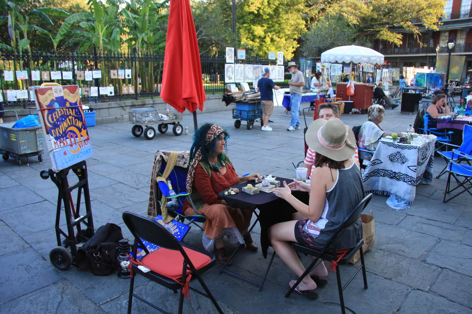 A couple meets with one of the French Quarter's fortune tellers outside of St. Louis Cathedral. #12 in Besting Things to Do in the French Quarter.