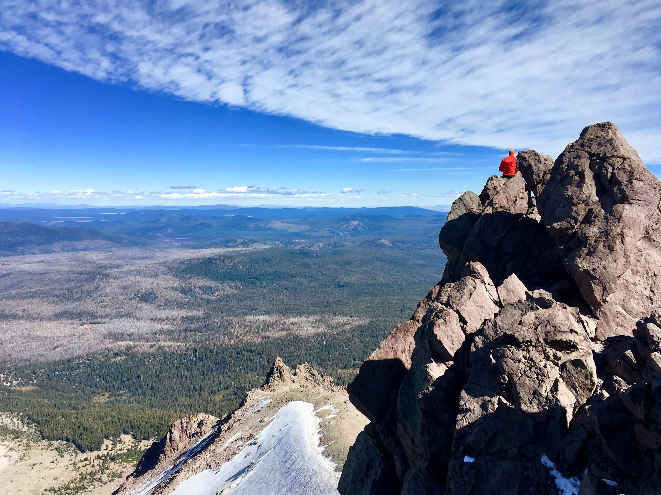 Sitting on the top of Lassen Peak, watching the birds fly by. Sitting on the top of Lassen Peak, wasting time.