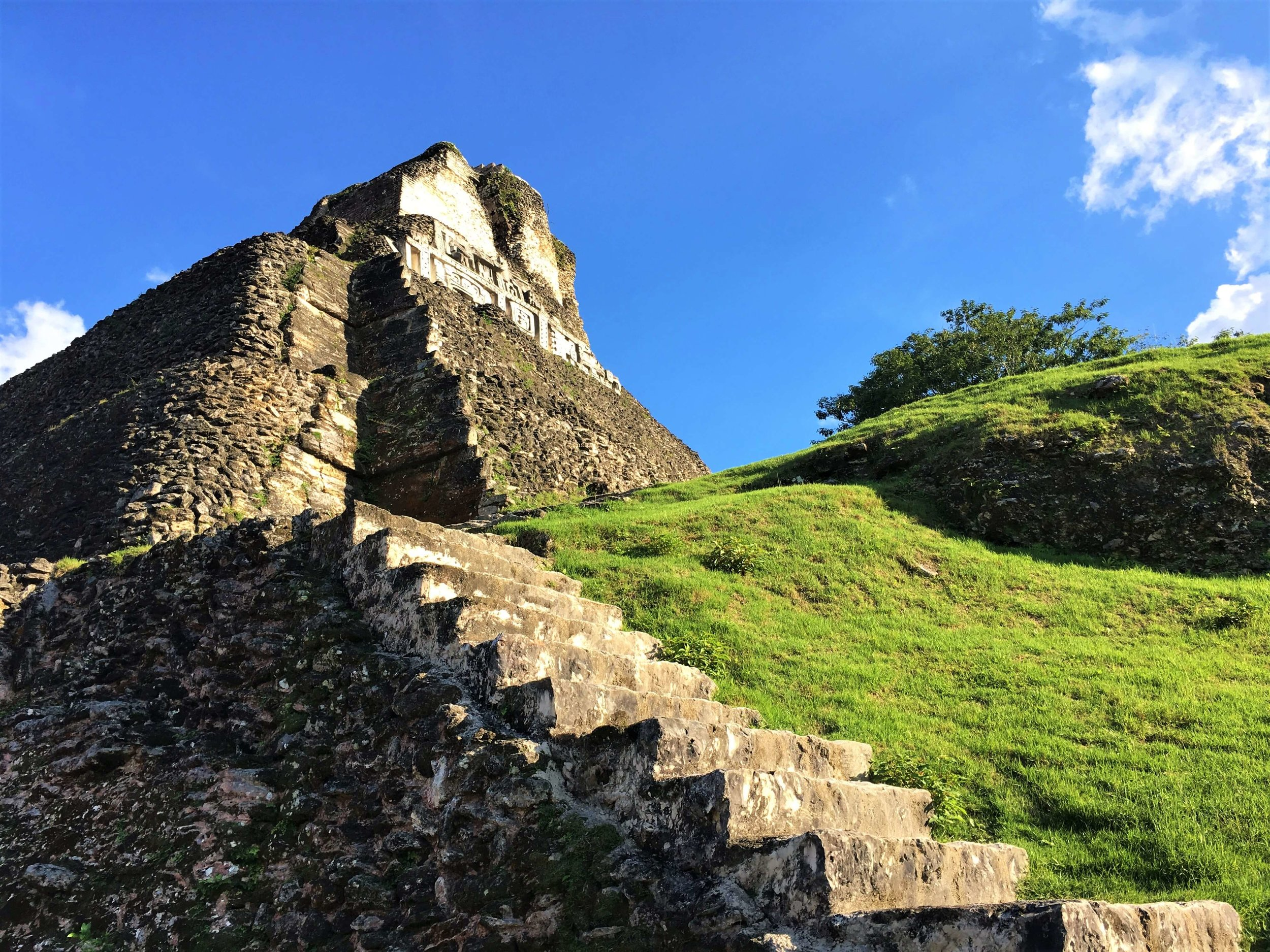A view from the side of the largest pyramid at Xunantunich Mayan Ruin. The best things to do in Belize.