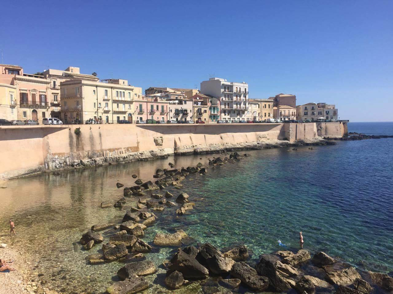 Ortigia, Syracuse in Italy is one of the best places to go for clear, relaxing blue waters.