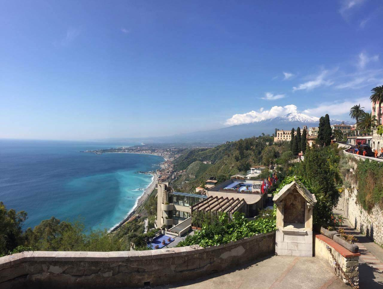With these kind of views in Taormina, you won't ever want to leave. The snow a top of Mt. Etna contrasted by the blue lagoon down below really can throw off your senses.